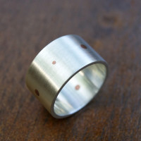 silver ring with copper dots