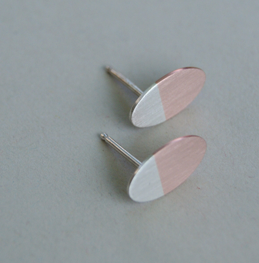 silver and copper oval earings
